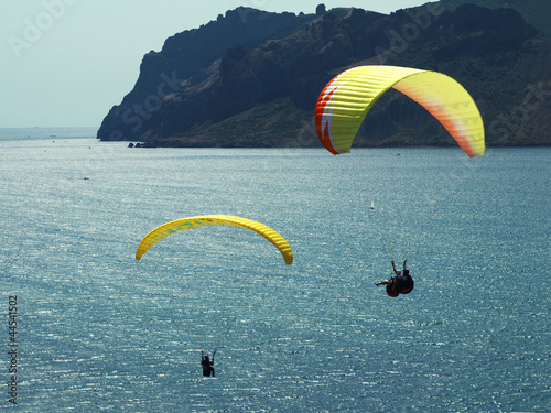 paragliding in the blue sky