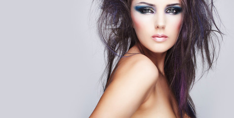 beautiful woman with long colored brown hair and bright makeup