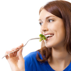 Cheerful woman eating broccoli, over white