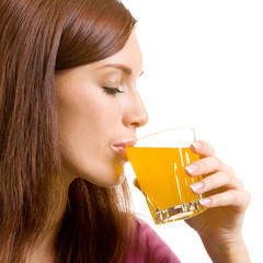 Beautiful woman drinking juice, over white