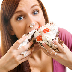 Cheerful woman eating pie, over white