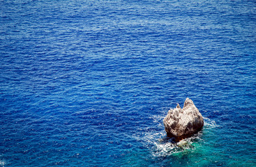Single rock on Ionian Sea near Paleokastritsa on Corfu, Greece