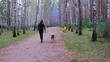 A young woman walking with a dog