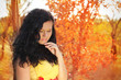 Autumn portrait of beautiful brunette woman model with bright ma