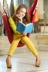 Young beautiful student girl  in hammock
