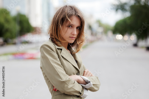 Sad young woman on a city street