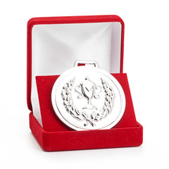 silver medal in red gift box.