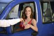 woman receiving keys of her new car