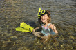 Happy cute snorkel girl on vacation