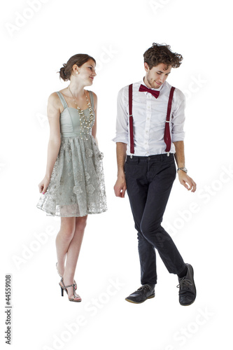 Shy teen couple wearing formal party clothes