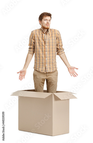 Young man doesn't know why he is inside the box
