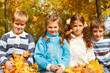 Yellow leaves falling on kids