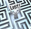 Lost Man Holding Sign in Labyrinth Maze