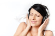 Woman in underwear listens to music through the black headphones
