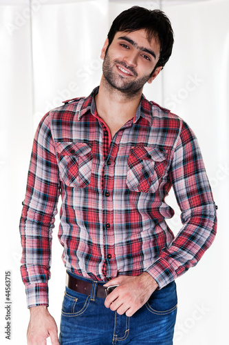 portrait of a happy man wearing checkered shirt