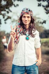 Hippie Portrait showing Peace Sign