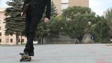 Confident businessman having fun on skateboard outdoor