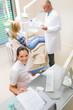 Dental surgery professional team patient top view