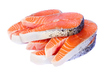 raw salmon steaks isolated on white background
