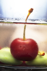 still life of cherries and ice cubes