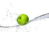 Fototapety  Fresh apple with water splashing, isolated on white background
