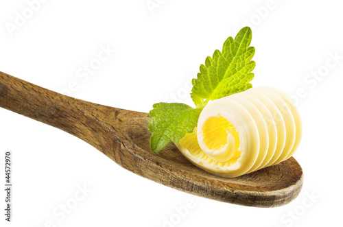 Butter curl on wooden spoon