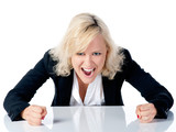 Young business woman screams on white background