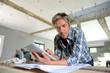 Leinwanddruck Bild - Entrepreneur in house under construction checking plan