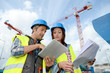 Construction manager and engineer working on building site - 44575141