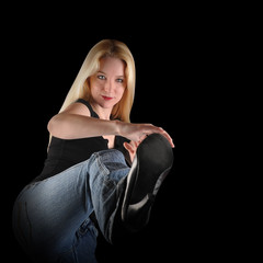 Woman Kicking on Black Background