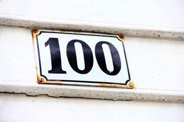 Enameled house number one hundred