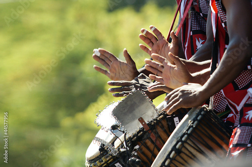 Hands beating drums