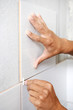 tiler hands at home renovation work