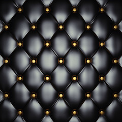 Black leather upholstery pattern with gold buttons