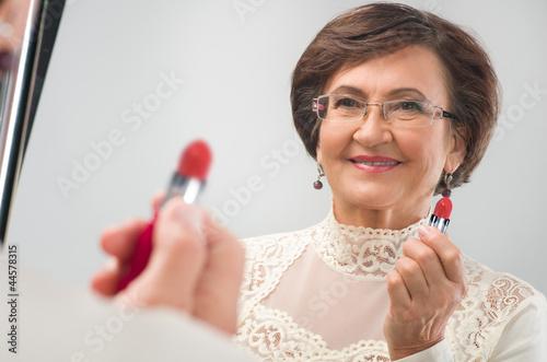 senior woman near the mirror