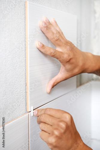 tiler hands at home renovation work