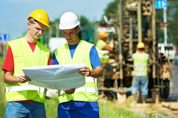Engineers builders at road works construction site