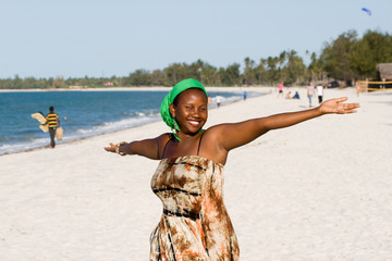 Uganda Woman enjoys the Beach