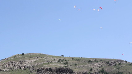 Paragliders on top of the Hill