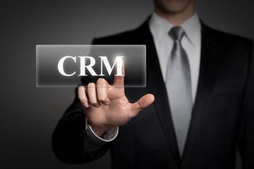 businessman pressing virtual button - CRM
