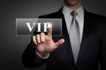 businessman pressing virtual button - VIP