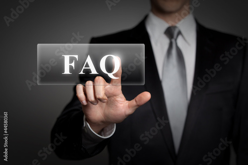 businessman pressing virtual button - FAQ