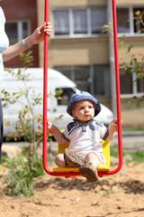 Baby swinging on swing