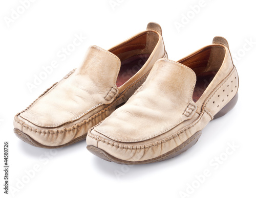 Pair of brown male loafers isolated on white