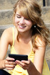 Teenager texting on mobile or cell phone