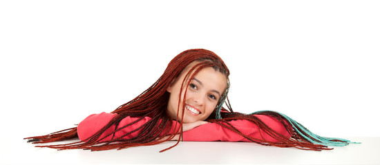 beautiful girl with braids resting her arms on table