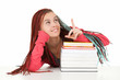 student woman with african plaits and books showing something