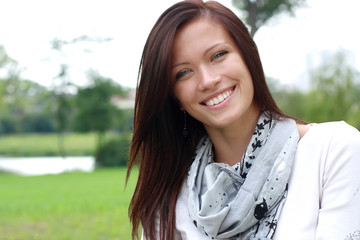 Portrait of a beautiful young woman outdoors smiling