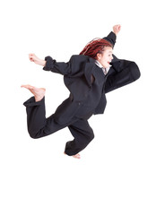 excited young woman in too big suit jumping or running