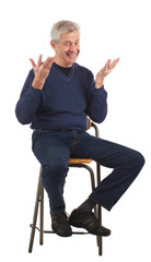 Happy senior man with upraised hands